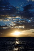 Sunset and clouds over the Pacific Ocean off the coast of Kihei, Maui, Hawaii, USA