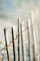 Weathered wooden fence on beach on Bald Head Island, North Carolina