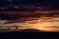 Sunset over Pacific Ocean with clouds in Maui, Hawaii, USA