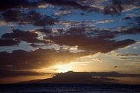 Sunset clouds over the coast of Kihei, Maui, Hawaii, USA