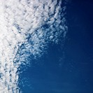 Cloud formations against clear blue sky