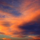 Orange clouds in sky with sunset