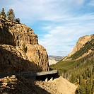 Highway winding through steep Wyoming mountains