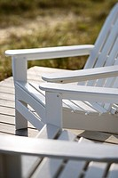Close_up of Adirondack chairs on deck