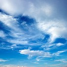 Wispy cloud formations against clear blue sky
