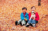 Kids And A Dog Sitting On Autumn Leaves,Korean