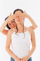 Mother Covering Daughter´s Eyes With Her Hands,Korean