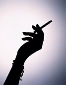 Silhouette Of Hand Holding Cigarette