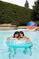 Teenage couple with swim ring