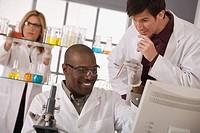Scientists experimenting in lab