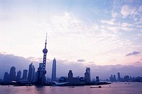 Shanghai City Under a Light Sky, Surrounded By the Ocean Water, Low Angle View, Shanghai, China