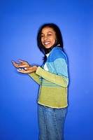 Portrait of African_American teen girl with palms turned upward.