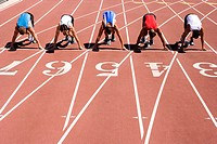 Male sprinters on starting blocks, elevated view