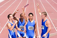 Group of male athletes with arms raised in celebration, elevated view (thumbnail)