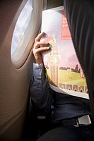 Man reading in plane