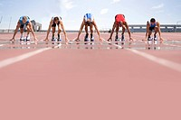 Sprinters on starting blocks, ground view