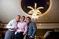 Young men in casino, smiling, portrait, low angle view