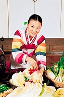 Woman In Korean Costume Making Kimchi,Korea
