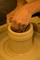 Clay being molded on a pottery wheel.