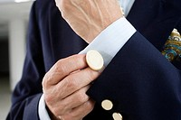 Close up of a man wearing cufflink.
