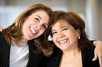 Portrait of two smiling women.