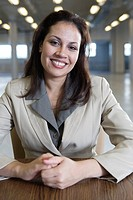 Portrait of a business woman smiling in office.