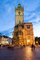 Czech Republic, Prague, cobbled Town square and Old Town Hall Tower at dusk