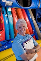 Elderly clerk in kayak shop