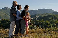 France, Cevenes Mountains, family including two kids 7_13 embracing, side view