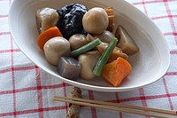 Bowl of Japanese vegetables with chopsticks, close_up