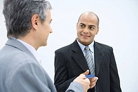 Two businessmen exchanging business card