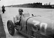 """Williams"" at the wheel of a Bugatti Type 51 racing car, Nurburgring, 1931.Photograph by Zoltan Glass. British Grand Prix racing driver Charles Freder..."