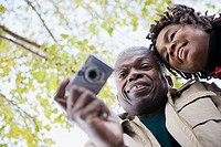 A couple using a camera