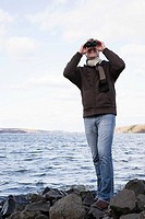 A man using binoculars