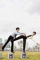 Businessman helping colleague (thumbnail)