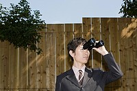 A businessman using binoculars (thumbnail)