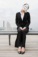 A businesswoman wearing a mask