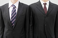 Businessmen wearing suit jackets
