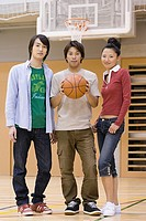 Friends on basketball court