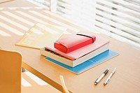 Books and pens on desk