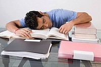 A man tired from studying