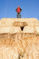 A boy standing on hay