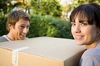 Couple with cardboard box