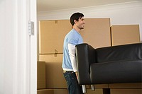 Man moving sofa