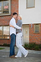 Couple outside new house