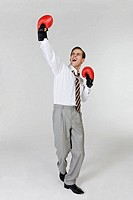 Man wearing boxing gloves with cheering