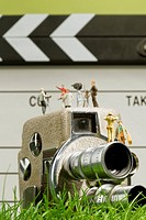 Miniature dolls on camera with clapper board