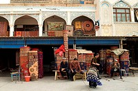 China, Xinjiang, kashgar, carpets merchant