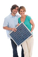 Couple holding solar panel