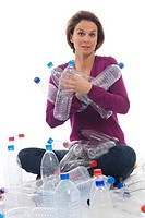 Woman holding plastic bottles